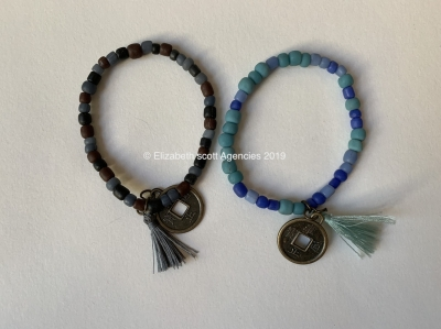 Glass Bracelet With Coin Charm and Tassel